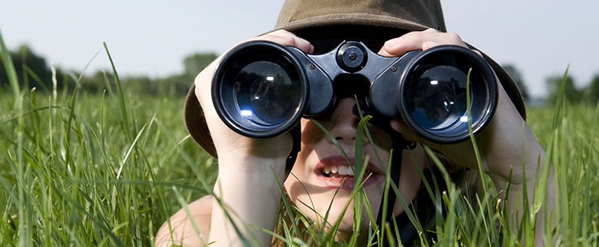 person looking through binoculars
