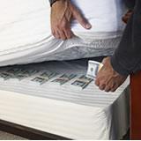 Hiding money under mattress